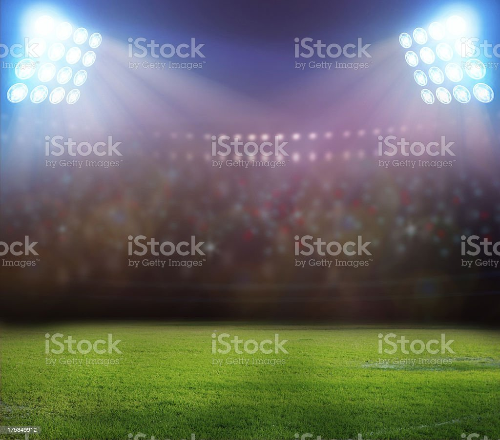 Stadium with lots of people and two spotlights on royalty-free stock photo