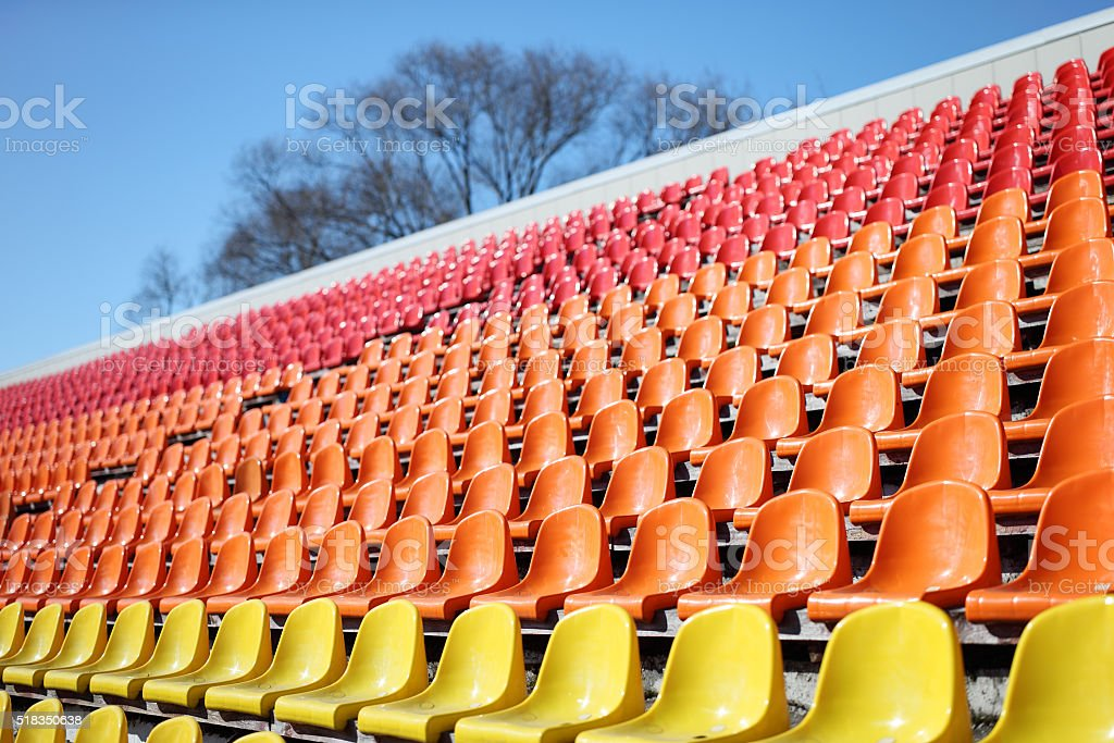 stadium with red seats stock photo