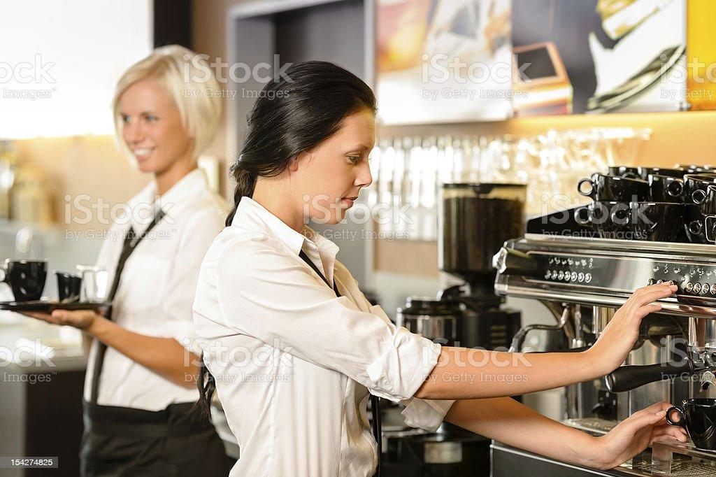 Staff at cafe making coffee espresso machine stock photo
