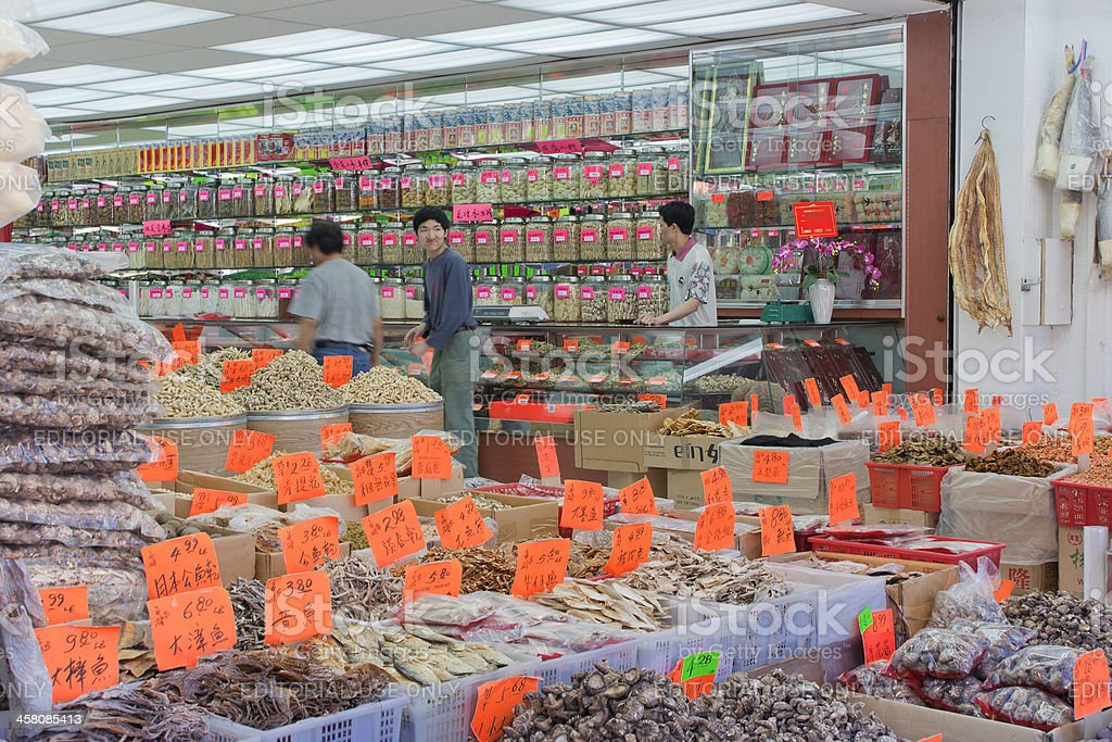 Staff in traditional Chinese Medicine Store, Chinatown of Vancouver royalty-free stock photo