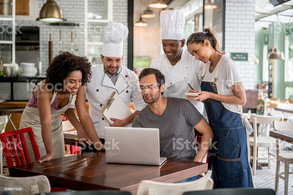 Staff meeting at a restaurant stock photo