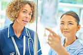 staff nurse advising young nurse