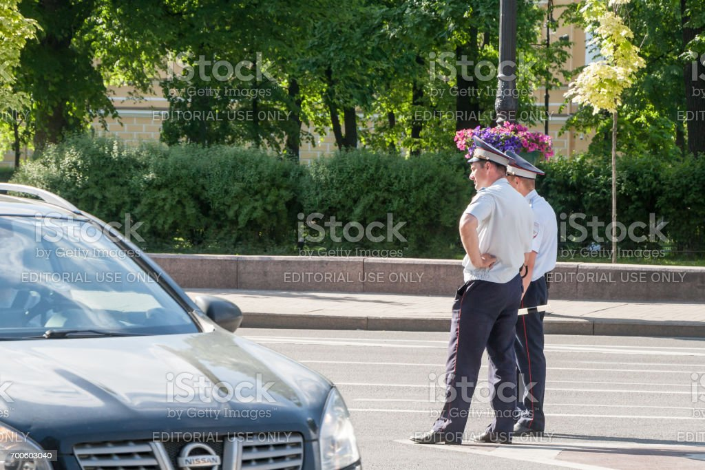 Staff of traffic police patrol traffic in St. Petersburg stock photo