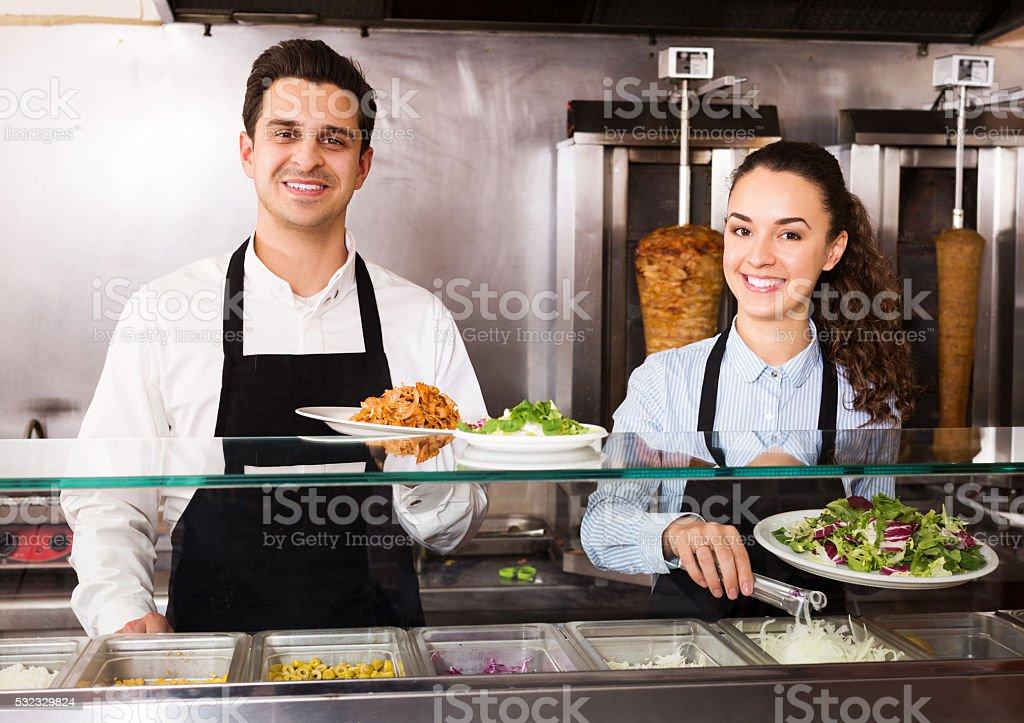 Staff posing at kebab counter stock photo