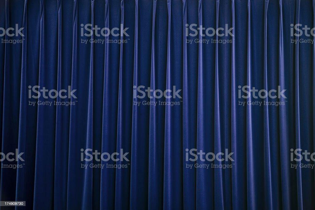 stage curtain blue velvet stock photo