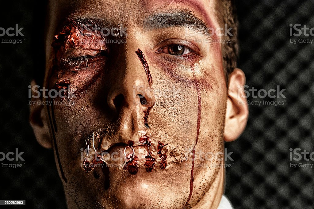Stage makeup beaten face  HDR Portrait  Young man   Ultimate fighter stock photo