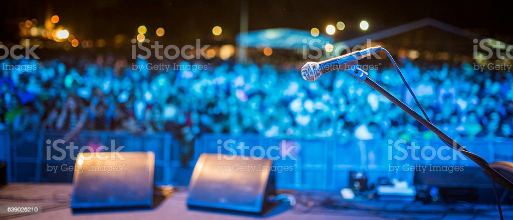 Stage microphone and concert crowd stock photo