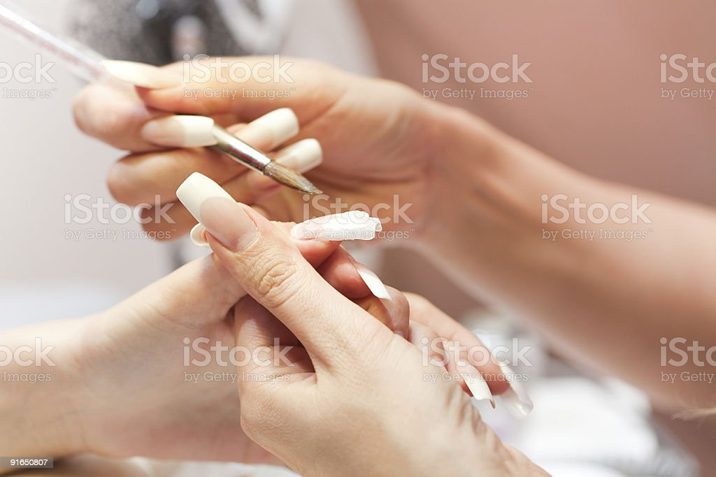 Stage of manicure: modeling nail with liquid acryl royalty-free stock photo