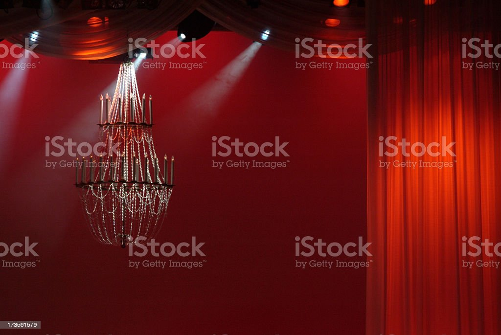 Stage Setting with Deep Red Curtains and Chandelier royalty-free stock photo