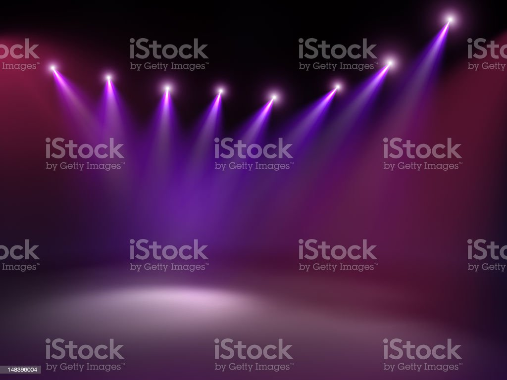 Stage with purple-hued lights shining down stock photo