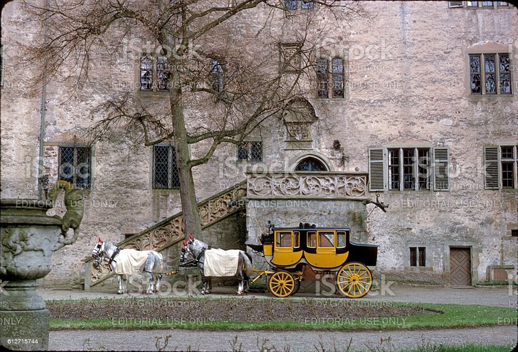 Stagecoach in the courtyard of the castle Aschach, Germany stock photo