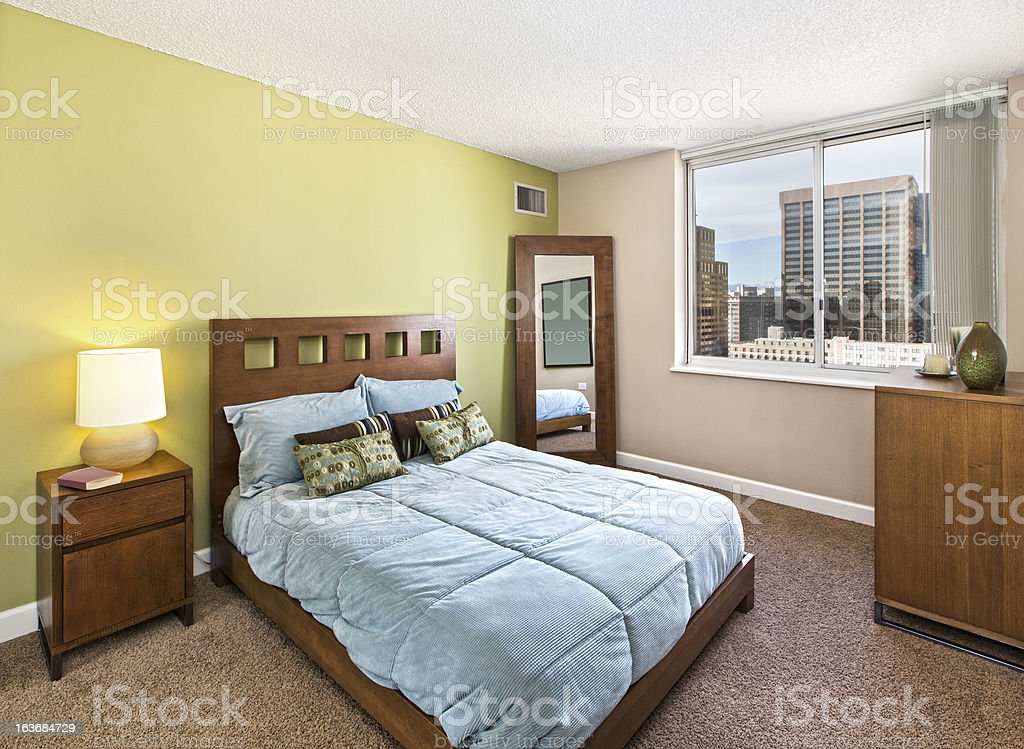 Staged Bedroom with contemporary decor royalty-free stock photo