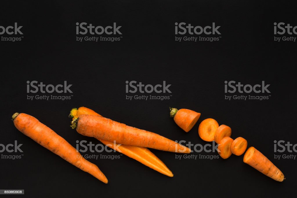 Stages of cutting carrot on black background stock photo