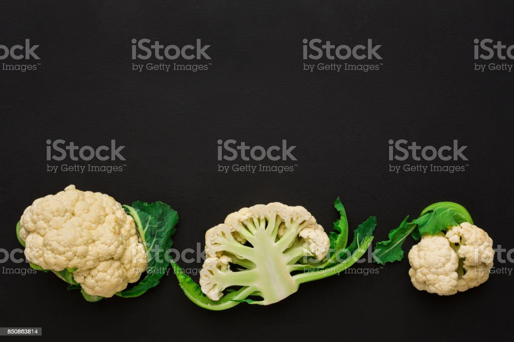 Stages of cutting cauliflower on black background stock photo