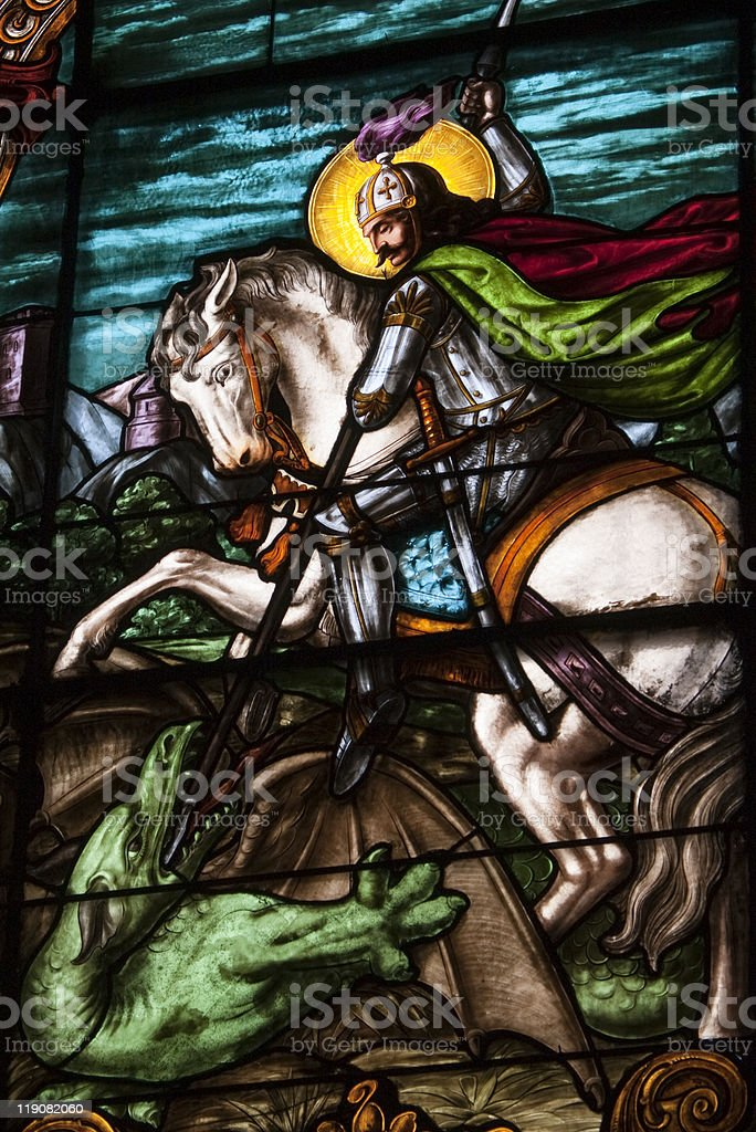 stain glass depicting saint george and dragon stock photo