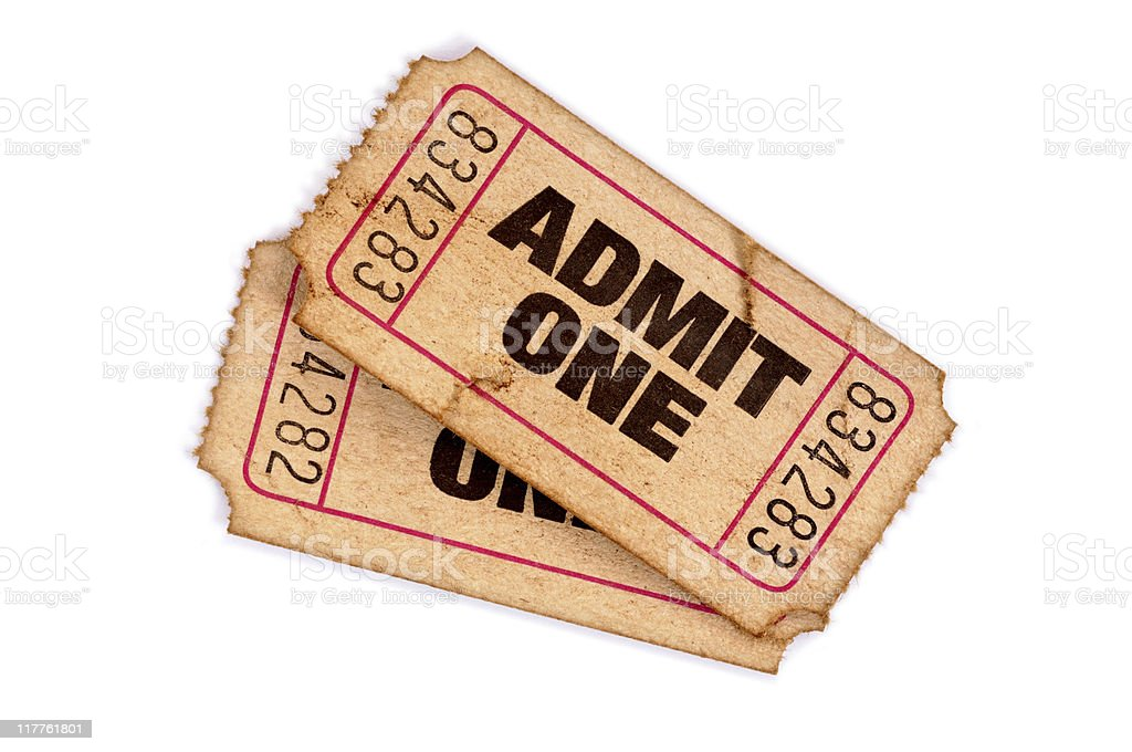 Stained and damaged admission tickets stock photo