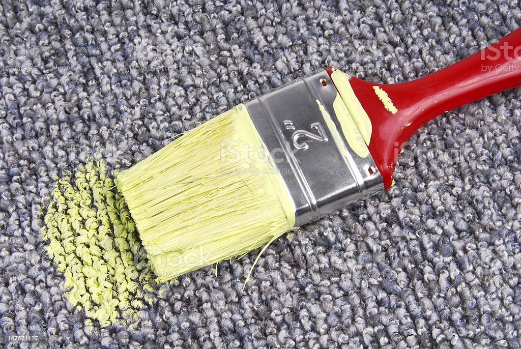 stained carpet with paint brush royalty-free stock photo