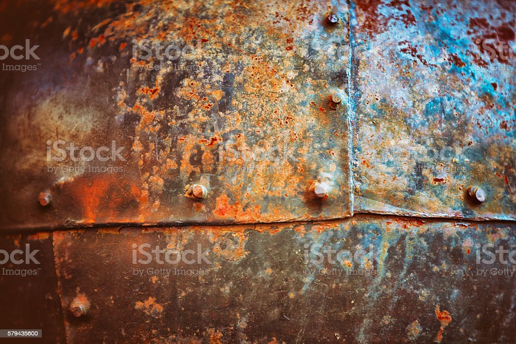 Stained Copper with Rivets Background stock photo