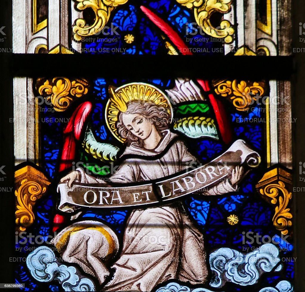 Stained Glass - Angel and Pray and Work stock photo