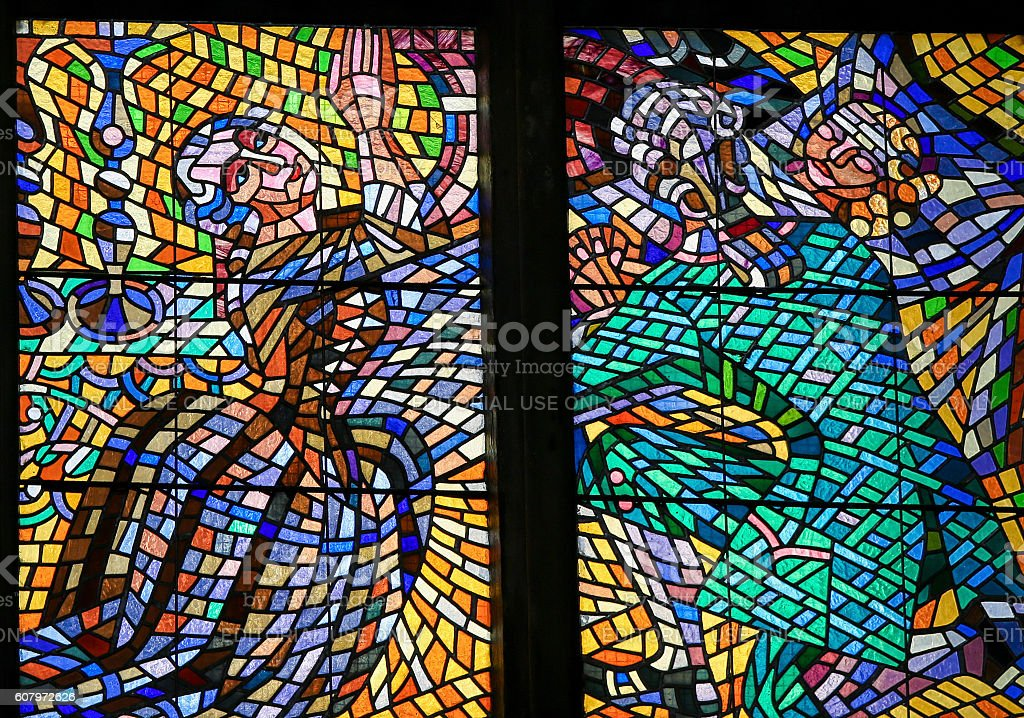 Stained Glass - Couple praying for their daughter stock photo