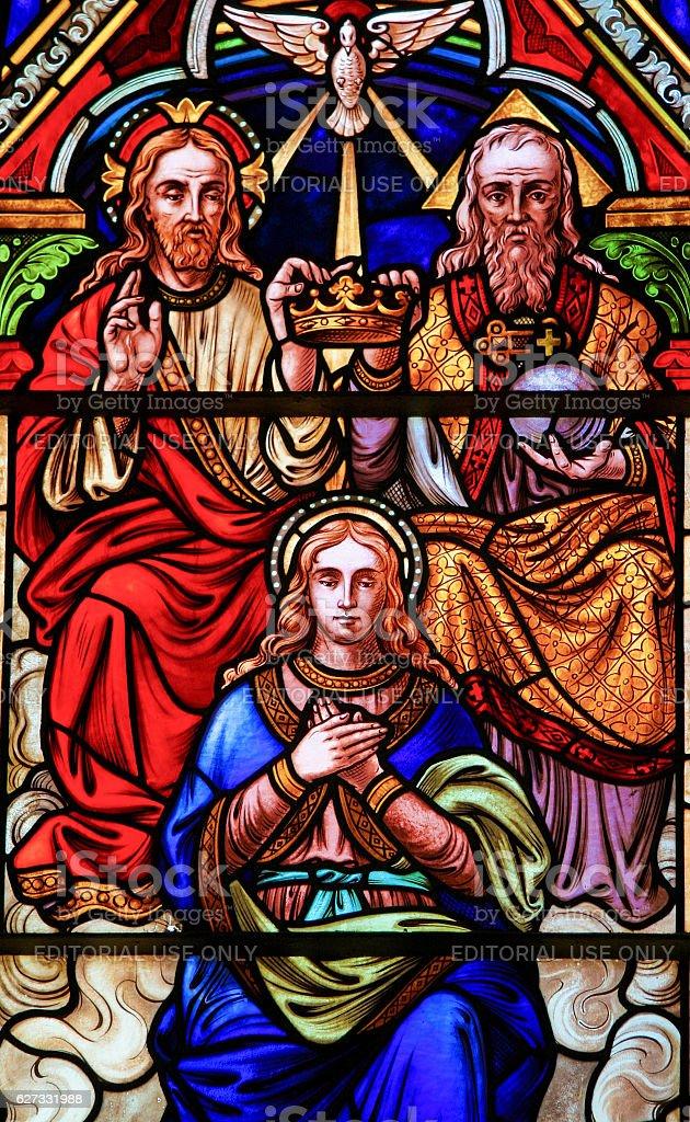 Stained glass in Bariloche - the Coronation of Mother Mary stock photo