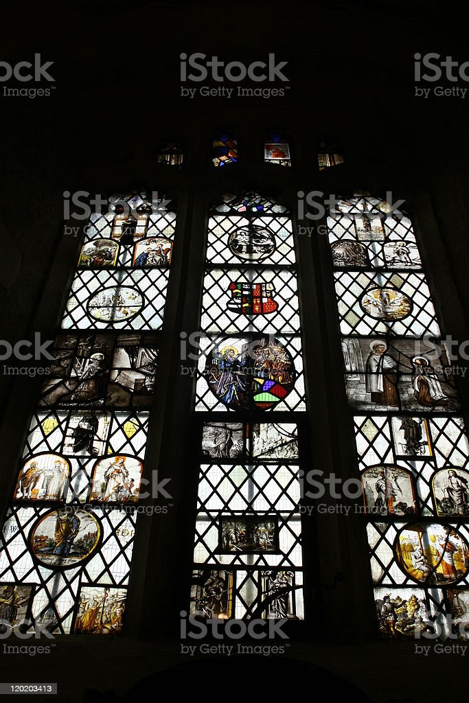 Stained glass in historical castle, South West England stock photo