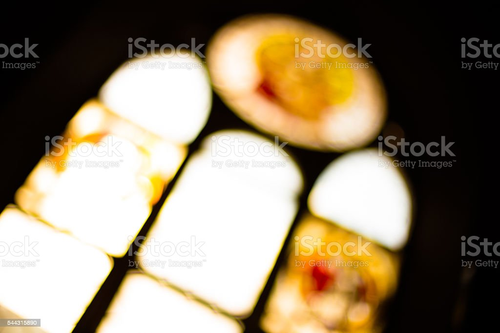 Stained glass in monastery, black background stock photo