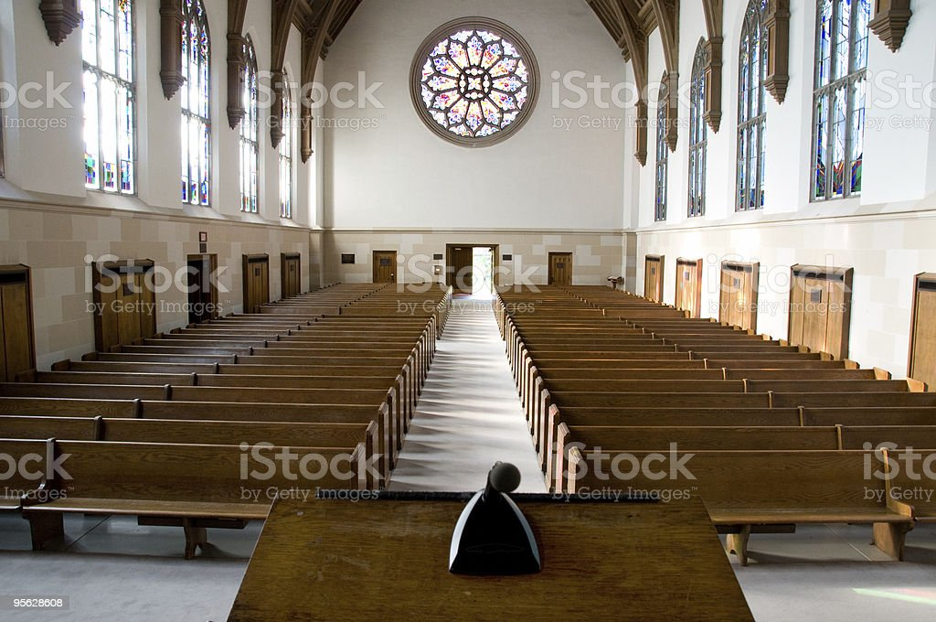 Stained Glass Light Dances on Pews stock photo