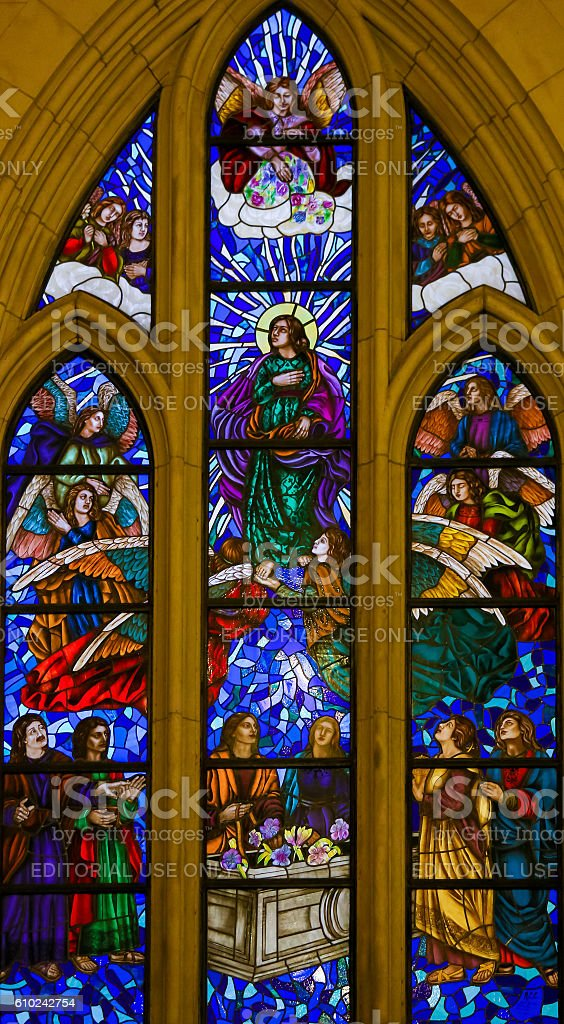 Stained Glass of Saint John the Evangelist in Madrid Cathedral stock photo