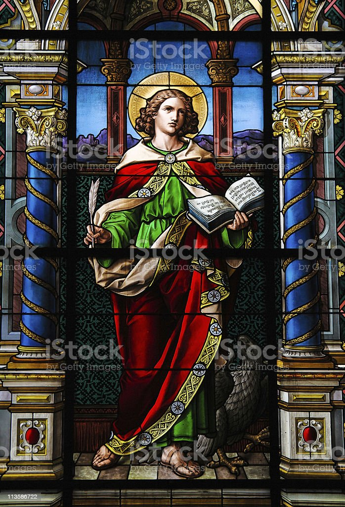 Stained glass of Saint John the Evangelist stock photo