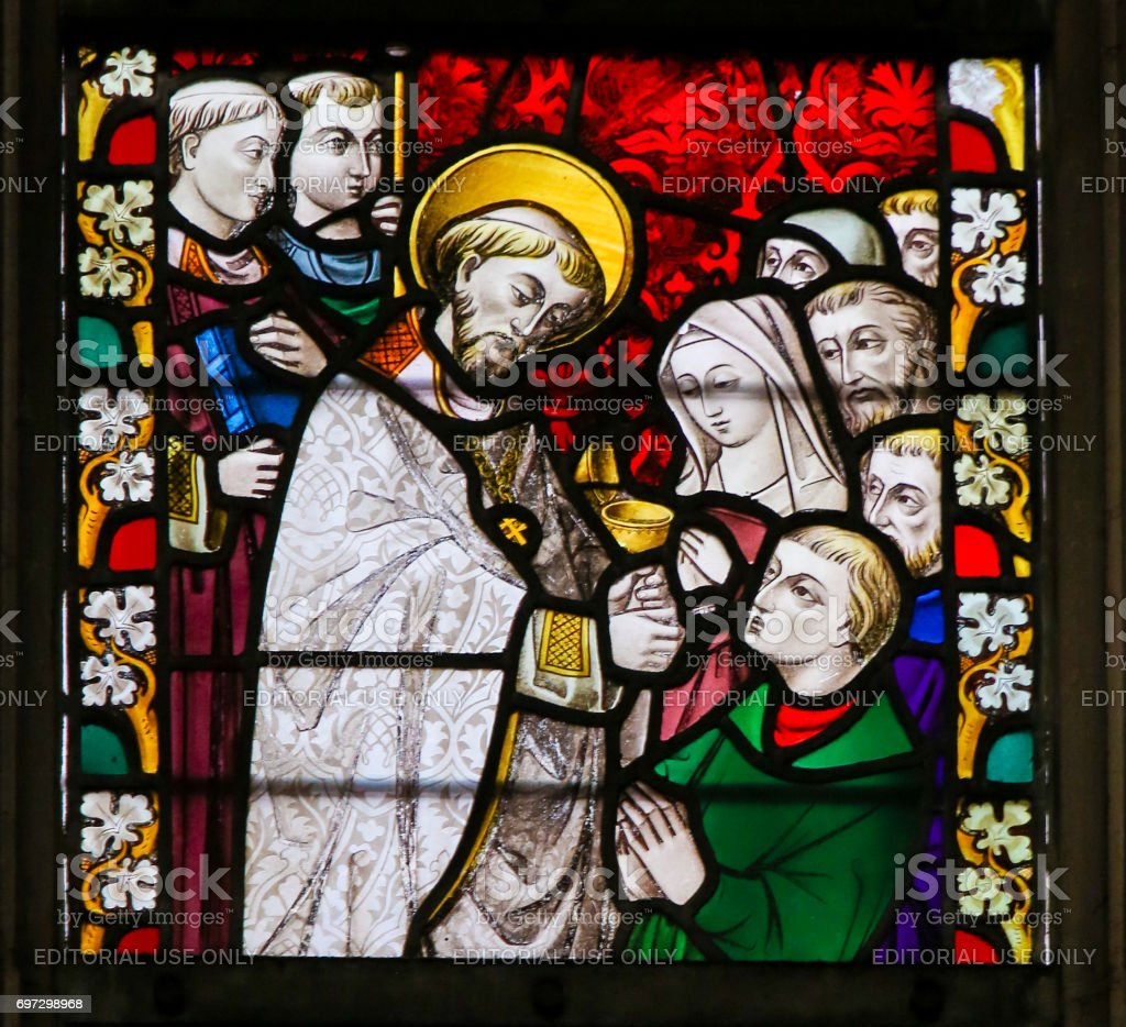 Stained Glass - Priest giving Holy Communion stock photo