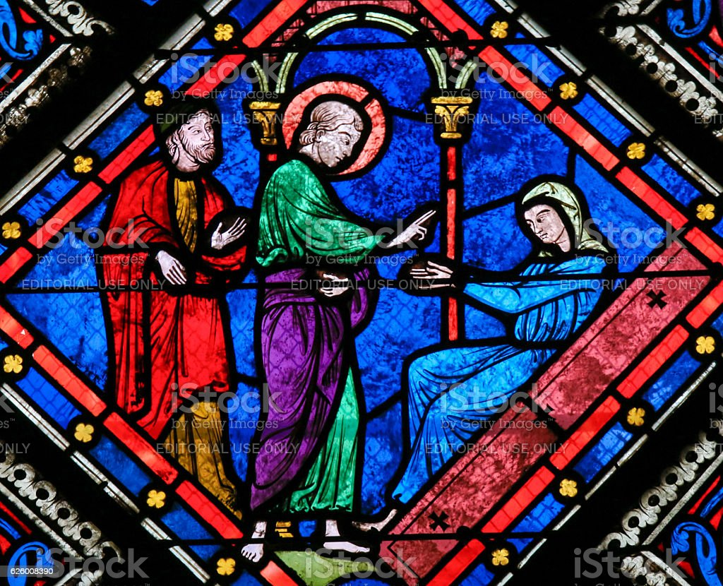 Stained Glass - Saint John the Evangelist and Mother Mary stock photo