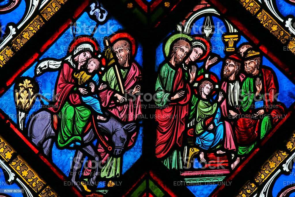 Stained Glass - The Flight to Egypt and Christ among stock photo