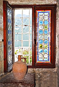 Stained glass window and old pitcher  in Montenegro