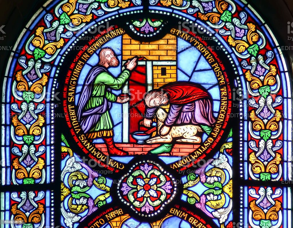 Stained glass window depicting sacrificing the lamb stock photo