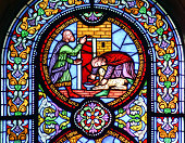 Stained glass window depicting sacrificing the lamb
