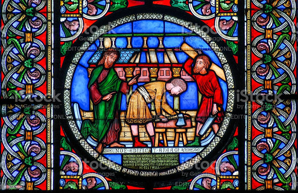 Stained glass window depicting the building of Noahs Ark stock photo