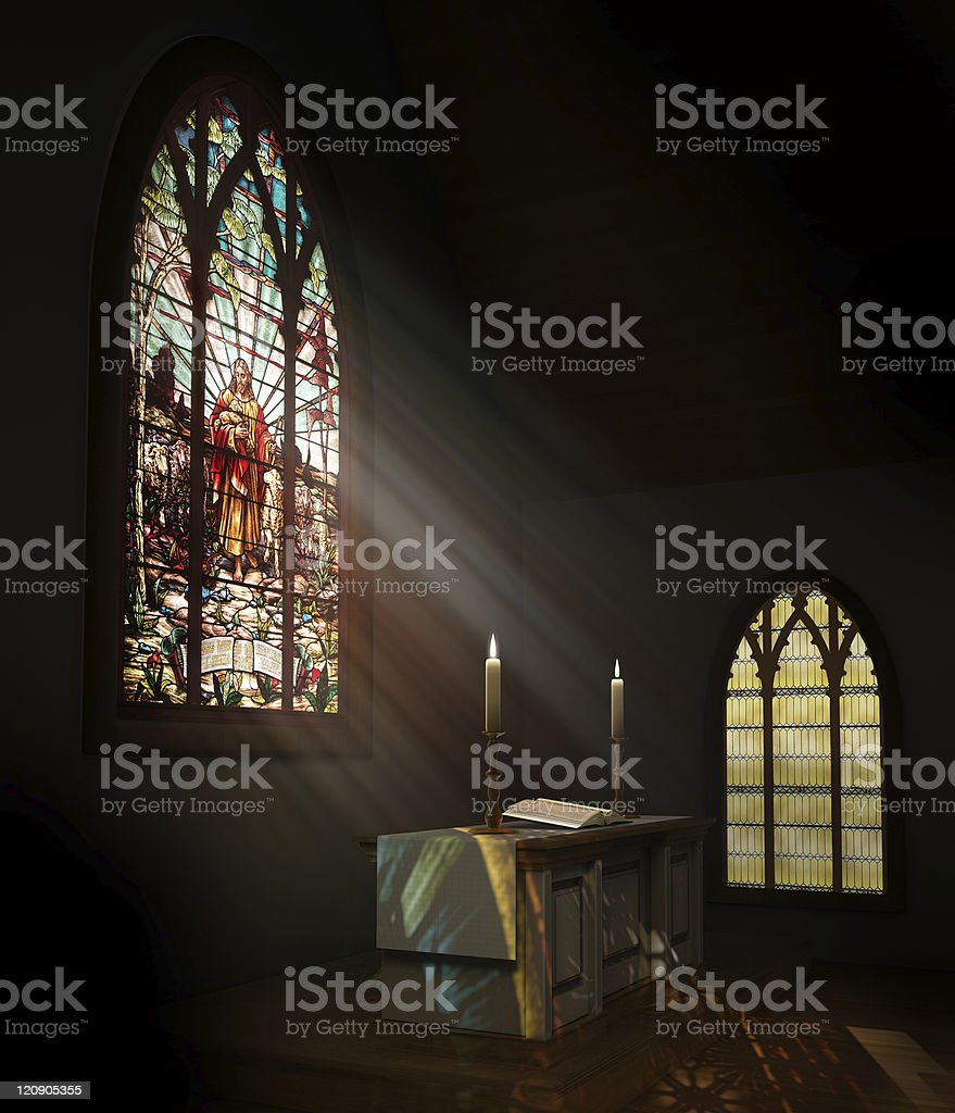 Stained glass window illuminates dark church stock photo