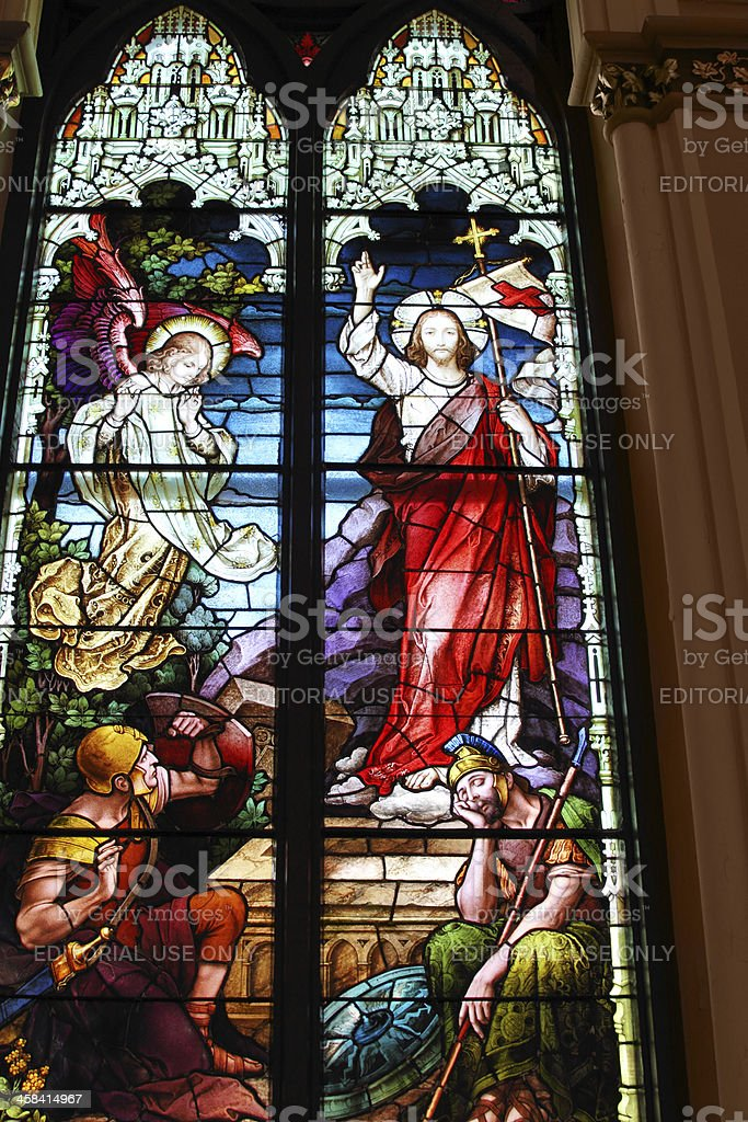 Stained glass window in a church depicting the resurrection royalty-free stock photo