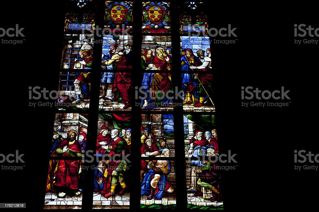Stained glass window in a Duomo Cathedral Milano royalty-free stock photo