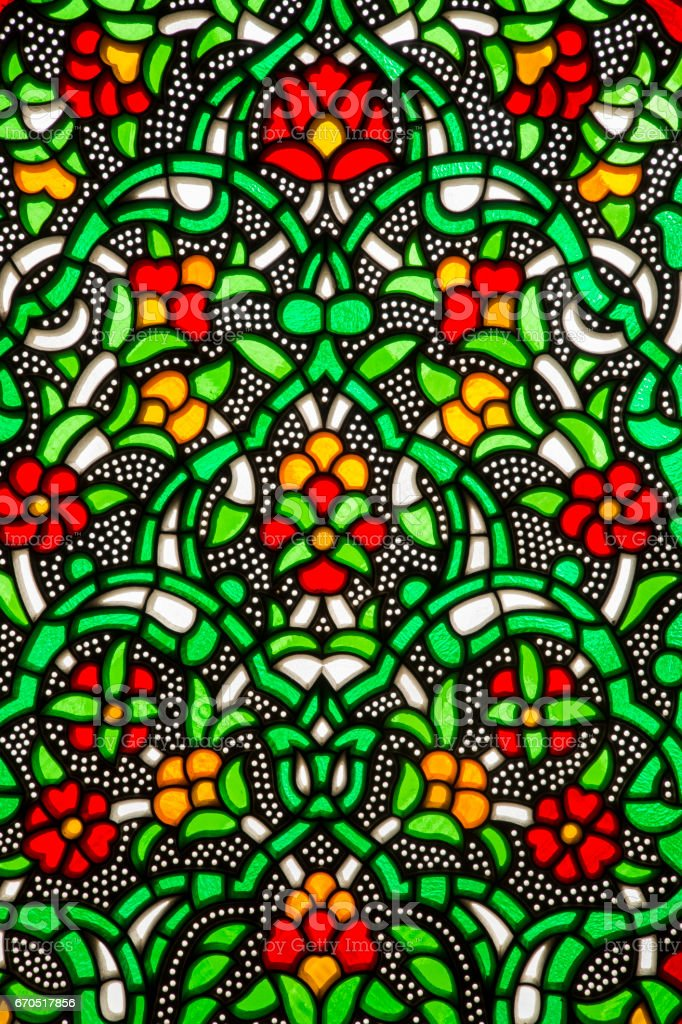 Stained glass window of colorful flowers for interior decoration. stock photo