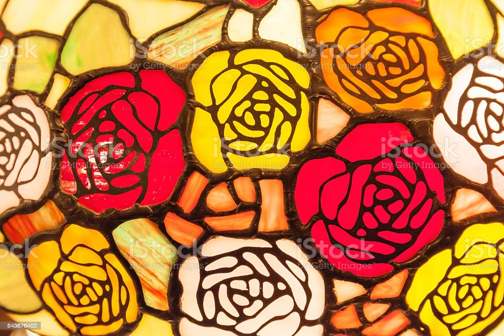 Stained glass window of colorful roses for interior decoration. stock photo