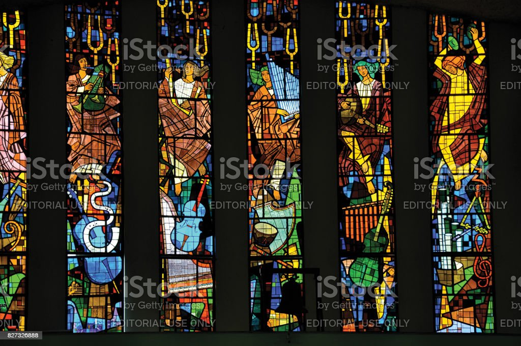 Stained glass windows with religious images in Santuário das Almas church. stock photo