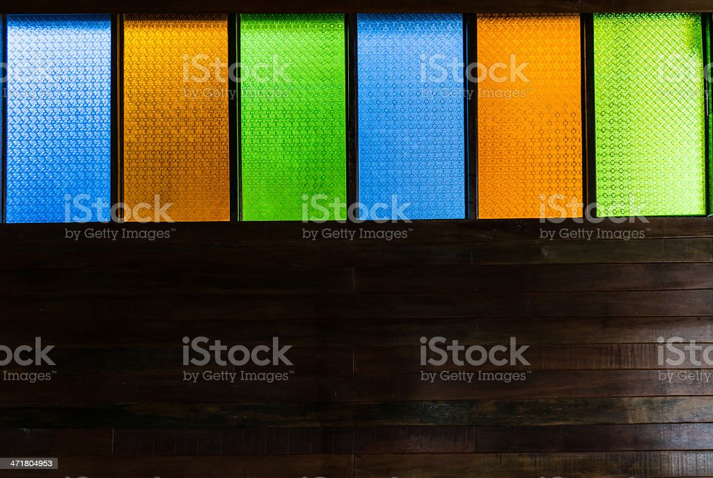 Stained glass, wood carving on the wall. royalty-free stock photo