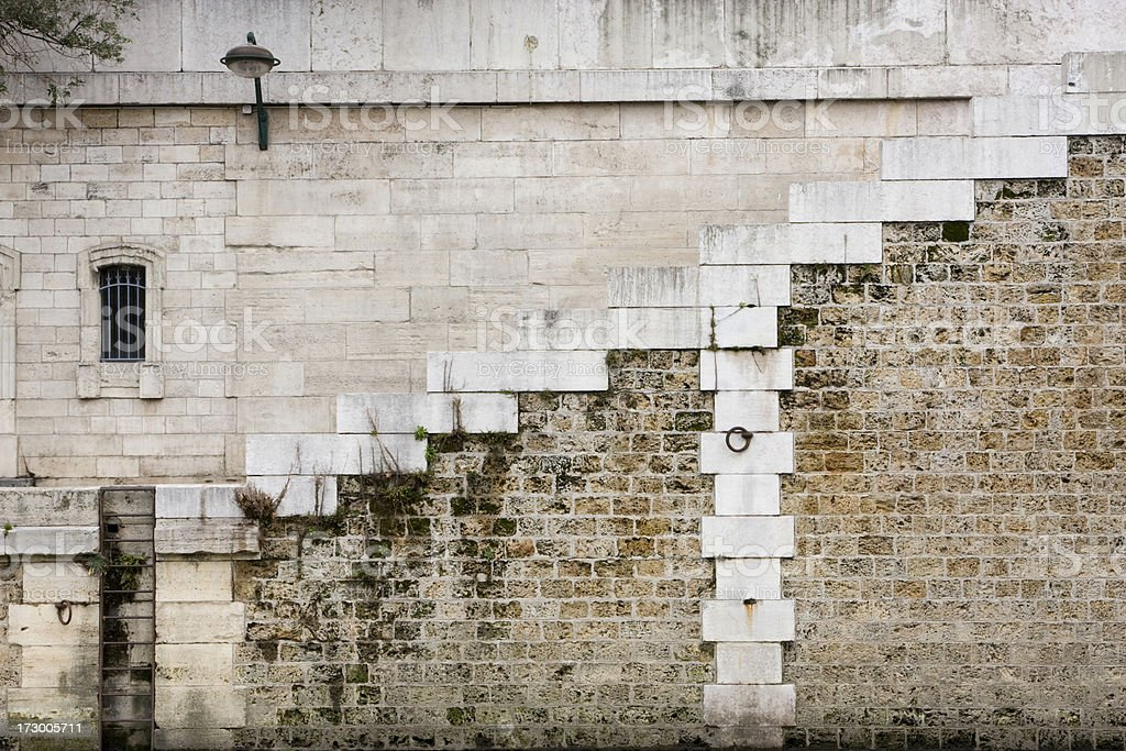 Stained Wall and Street lamp in Paris France royalty-free stock photo