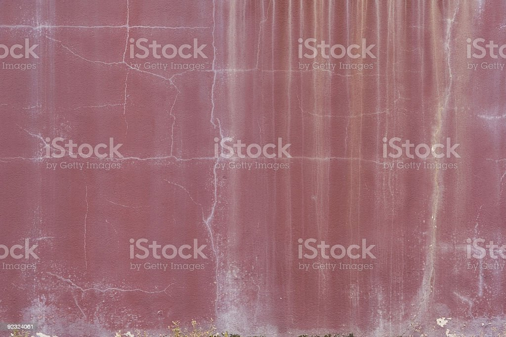 Stained worn and weathered old red wall royalty-free stock photo