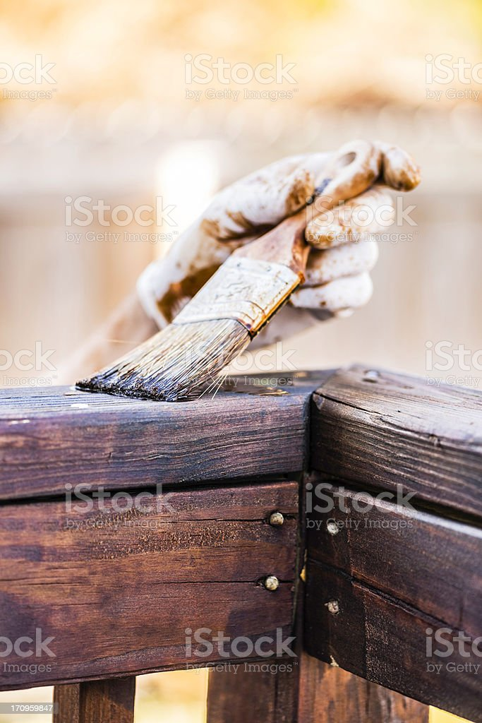 Staining a Deck for Winter stock photo