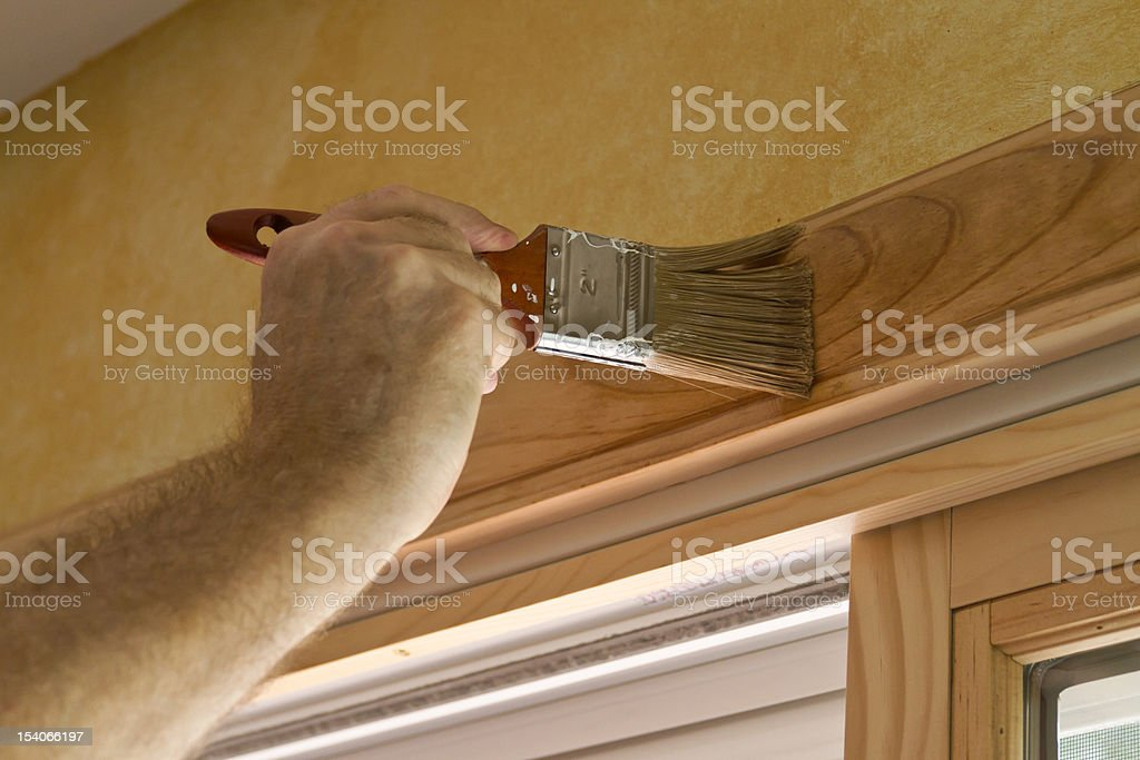 Staining a Doorway royalty-free stock photo