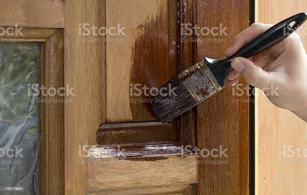 Staining an exterior door. stock photo
