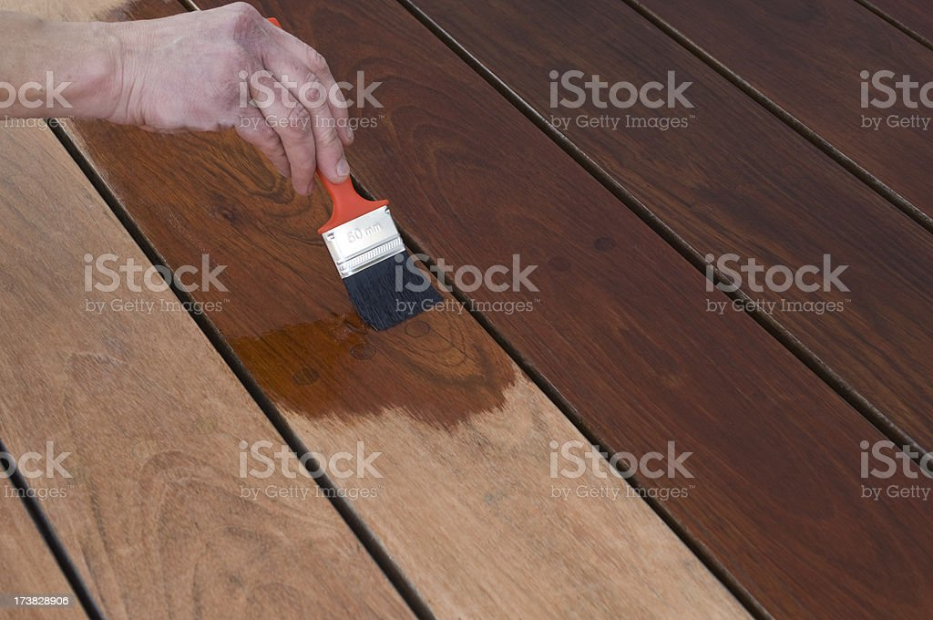 Staining Hardwood Patio Decking royalty-free stock photo